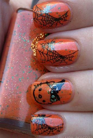 uñas de hello kitty naranjas para halloween